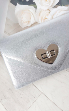 View the Lilly Metallic Heart Detail Clutch Bag online at iKrush