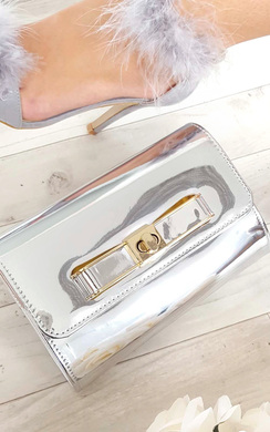 View the Nadia Metallic Bow Detail Clutch Bag online at iKrush