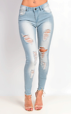 View the Lorina Mid Rise Skinny Ripped Jeans online at iKrush
