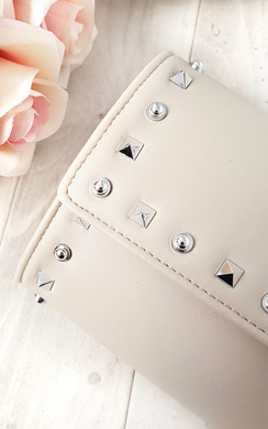 View the Rosa Quilted Gold Studded Clutch Bag online at iKrush