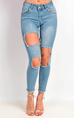 View the Matilda Skinny Mid Rise Ripped Jeans online at iKrush