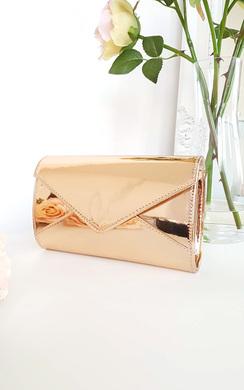 View the Amel Metallic Envelope Clutch Bag online at iKrush