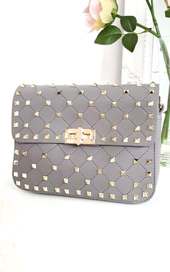 View the Liah Quilted Studded Shoulder Chain Bag online at iKrush
