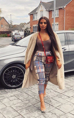 View the Abi Highwaisted Checked Trousers online at iKrush