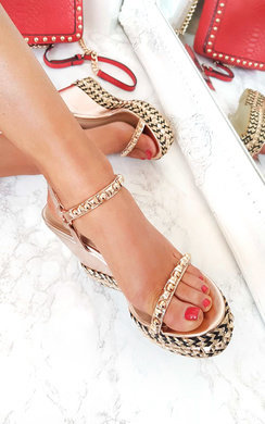 View the Alaia Studded Braided Strap Wedges online at iKrush