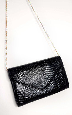 View the Avril Patent Envelope Clutch Bag online at iKrush
