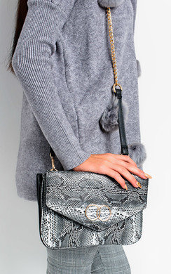 View the Betti Double Sided Envelope Shoulder Bag online at iKrush