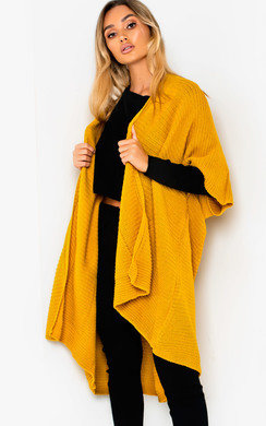 View the Cait Wrap Knitted Cape online at iKrush