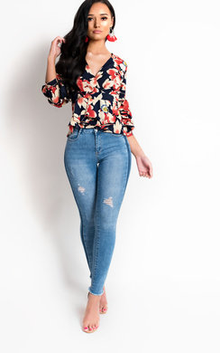View the Chrissy Floral Peplum Pleated Top online at iKrush