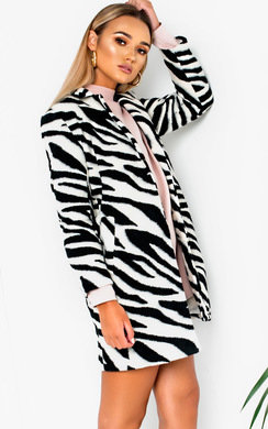 View the Karen Faux Fur Zebra Coat online at iKrush