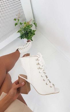 View the Karissa Peep Toe Lace-Up Block Heels online at iKrush