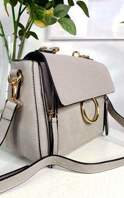 View the Lana Circle Detail Shoulder Bag online at iKrush