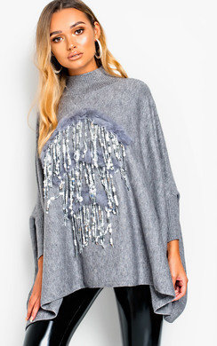 View the Lara Faux Fur Sequin Poncho online at iKrush