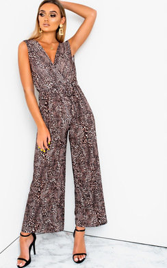 View the Mads Plunge Crimped Wide Leg Stretch Jumpsuit online at iKrush