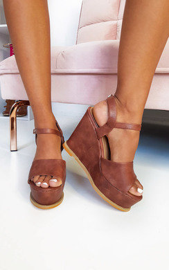 View the Myla Peep Toe Faux Leather Wedges online at iKrush