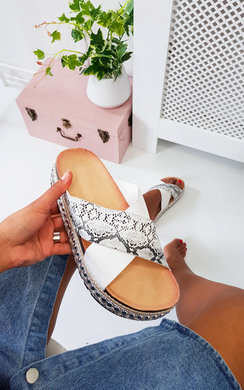 View the Rix Studded Snake Print Flatform Sandals online at iKrush