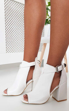 View the Ronnie Cut Out Block Heel Boots online at iKrush