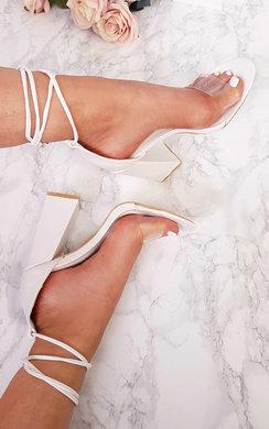 View the Rosella Perspex Tie Block Heels online at iKrush