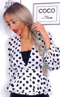View the Shelly Peplum Ruffle Polka Dot Top online at iKrush
