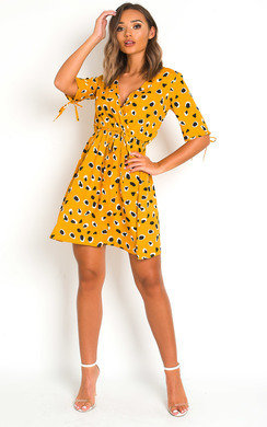 View the Sherri Printed Wrap Mini Dress online at iKrush
