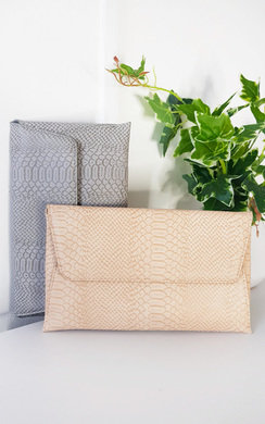 View the Tilda Faux Leather Envelope Clutch Bag online at iKrush