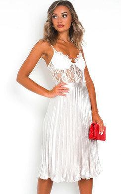 View the Trina Metallic Pleated Midi Skirt online at iKrush