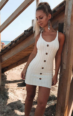 View the Tyla Knitted Button Mini Dress online at iKrush