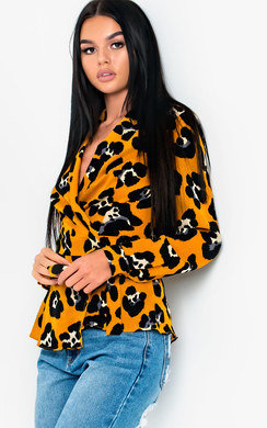View the Zeena Leopard Print Wrap Blouse Top  online at iKrush