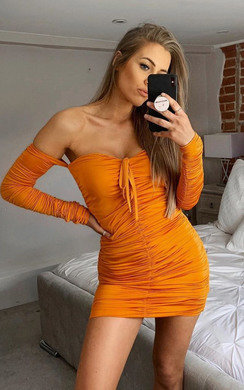 View the Zeena Ruched Off Shoulder Bodycon Dress online at iKrush