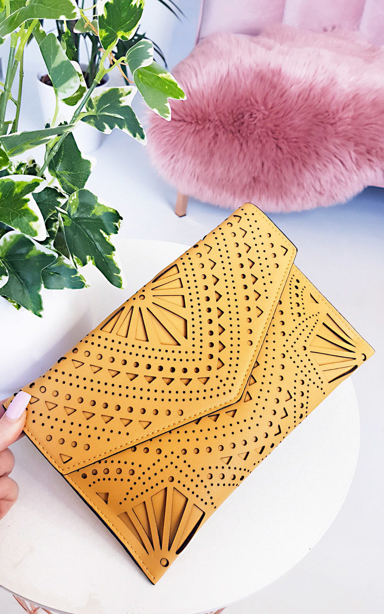 Image result for An envelope clutch with a cut-out pattern